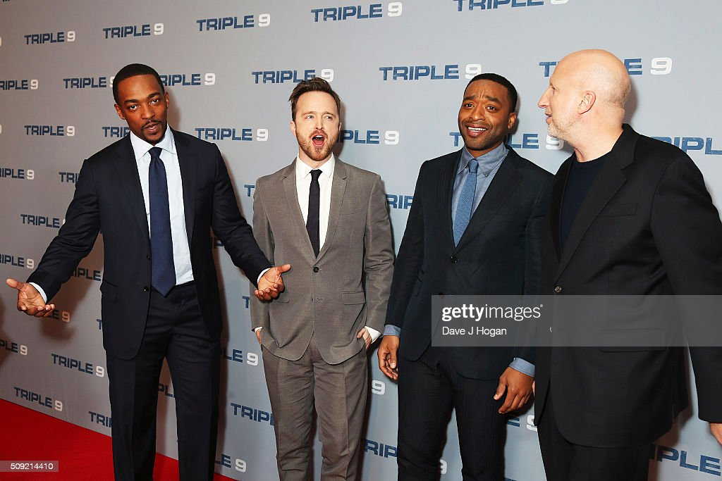<a gi-track='captionPersonalityLinkClicked' href=/galleries/search?phrase=Anthony+Mackie&family=editorial&specificpeople=206212 ng-click='$event.stopPropagation()'>Anthony Mackie</a>, Aaron Paul, <a gi-track='captionPersonalityLinkClicked' href=/galleries/search?phrase=Chiwetel+Ejiofor&family=editorial&specificpeople=213998 ng-click='$event.stopPropagation()'>Chiwetel Ejiofor</a> and Director <a gi-track='captionPersonalityLinkClicked' href=/galleries/search?phrase=John+Hillcoat&family=editorial&specificpeople=665204 ng-click='$event.stopPropagation()'>John Hillcoat</a> attend a special screening of 'Triple 9' at Ham Yard Hotel on February 9, 2016 in London, England.