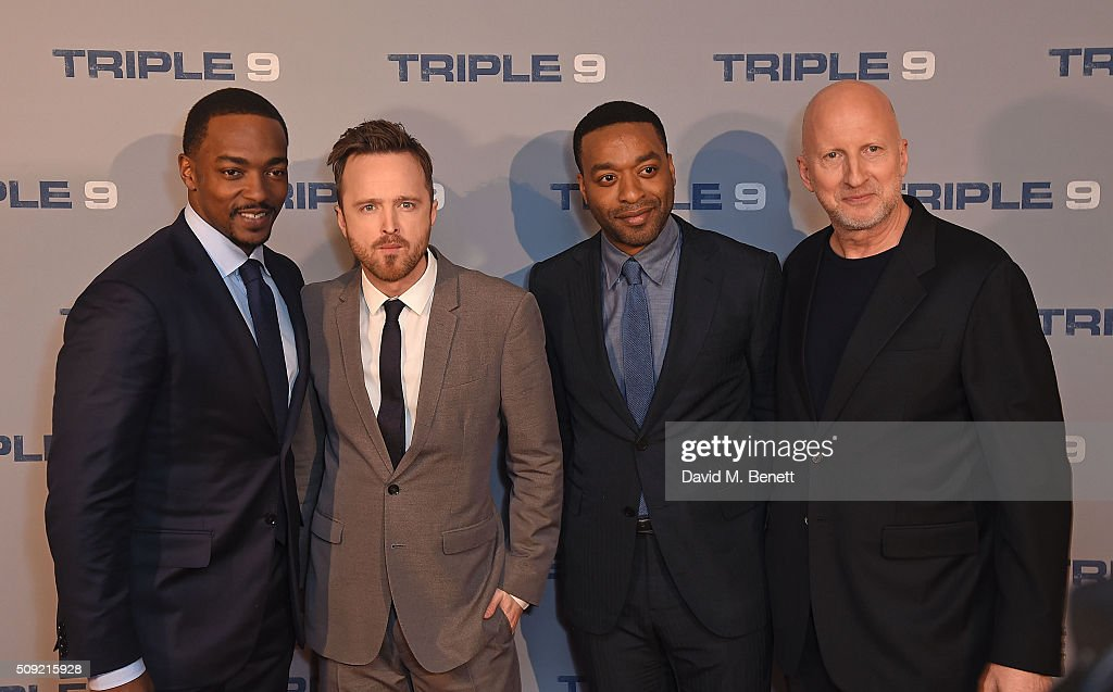 <a gi-track='captionPersonalityLinkClicked' href=/galleries/search?phrase=Anthony+Mackie&family=editorial&specificpeople=206212 ng-click='$event.stopPropagation()'>Anthony Mackie</a>, Aaron Paul, <a gi-track='captionPersonalityLinkClicked' href=/galleries/search?phrase=Chiwetel+Ejiofor&family=editorial&specificpeople=213998 ng-click='$event.stopPropagation()'>Chiwetel Ejiofor</a> and <a gi-track='captionPersonalityLinkClicked' href=/galleries/search?phrase=John+Hillcoat&family=editorial&specificpeople=665204 ng-click='$event.stopPropagation()'>John Hillcoat</a> attend a special screening of 'Triple 9' at The Ham Yard Hotel on February 9, 2016 in London, England.