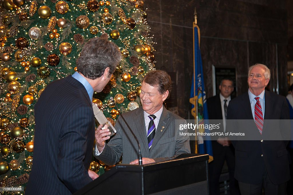 Anthony Malkin (L) of the Empire State Building presents 2014 US Ryder Cup Captain Tom Watson with a gift during the Empire State Building lighting ceremony in the lobby of the Empire State Building on December 13, 2012 in New York City.