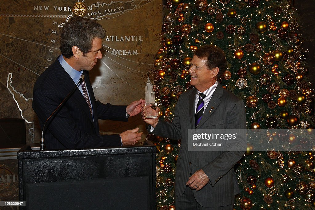 Anthony Malkin (L) presents Tom Watson with a crystal replica of the Empire State Building during the 2014 U.S. Ryder Cup Captain's News Conference held at the Empire State Building on December 13, 2012 in New York City.