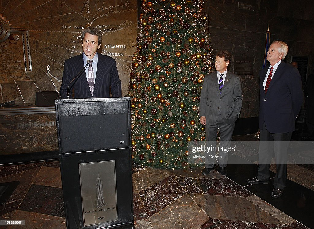 Anthony Malkin (L) speaks as Tom Watson (C) and Harold Meriam look on during a lighting ceremony after the 2014 U.S. Ryder Cup Captain's News Conference held at the Empire State Building on December 13, 2012 in New York City.