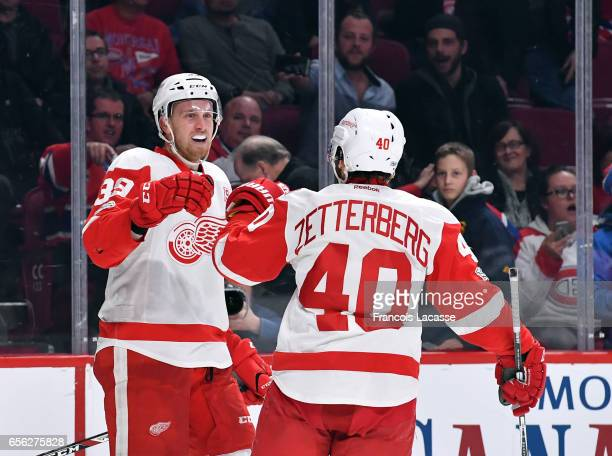 Anthony Mantha and Henrik Zetterberg of the Detroit Red Wings celebrate after defeating the the Montreal Canadiens in the NHL game at the Bell Centre...