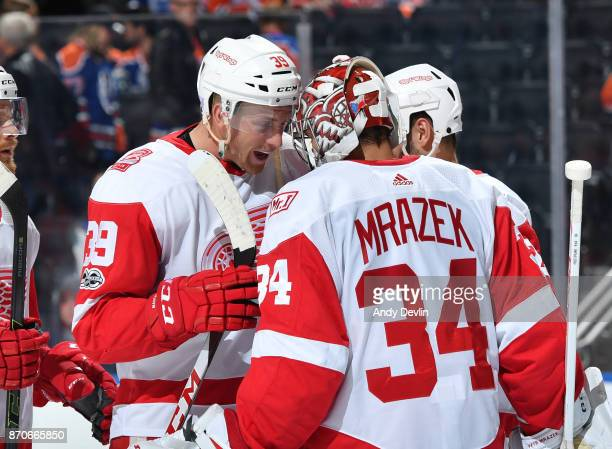 Anthony Mantha and Petr Mrazek of the Detroit Red Wings celebrate after winning the game against the Edmonton Oilers on November 5 2017 at Rogers...