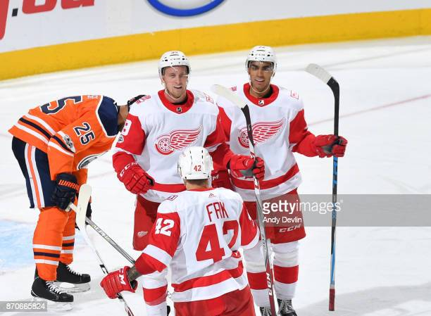 Anthony Mantha Andreas Athanasiou and Martin Frk of the Detroit Red Wings celebrate after a goal during the game against the Edmonton Oilers on...