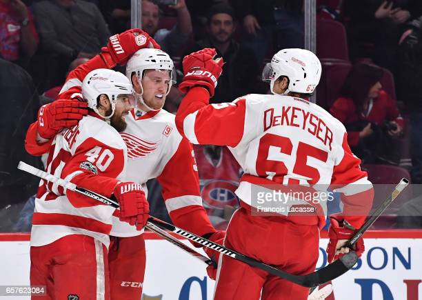 Anthony Mantha Danny DeKeyser and Henrik Zetterberg of the Detroit Red Wings celebrate after defeating the the Montreal Canadiens in the NHL game at...