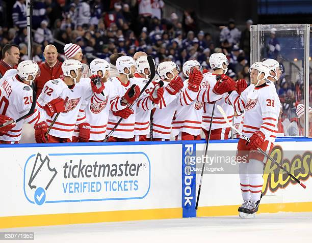 Anthony Mantha of the Detroit Red Wings celebrates with the bench after scoring a first period goal on the Toronto Maple Leafs during the 2017...