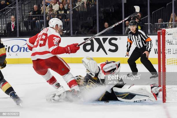 Anthony Mantha of the Detroit Red Wings collides with goalie MarcAndre Fleury of the Vegas Golden Knights during the game at TMobile Arena on October...