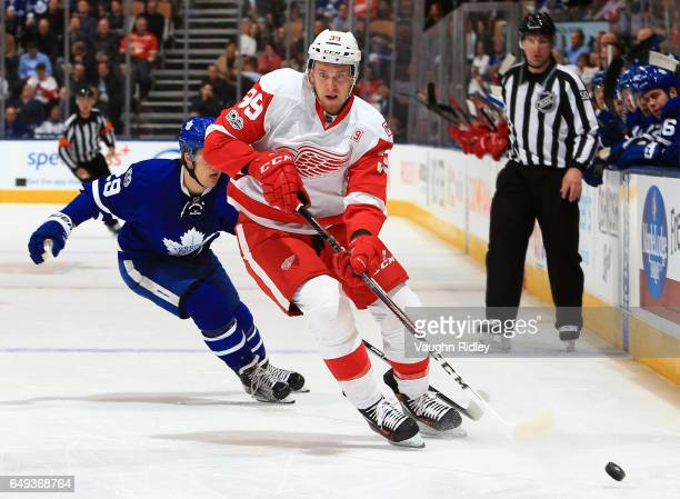Anthony Mantha of the Detroit Red Wings is chased by William Nylander of the Toronto Maple Leafs during an NHL game at Air Canada Centre on March 7...
