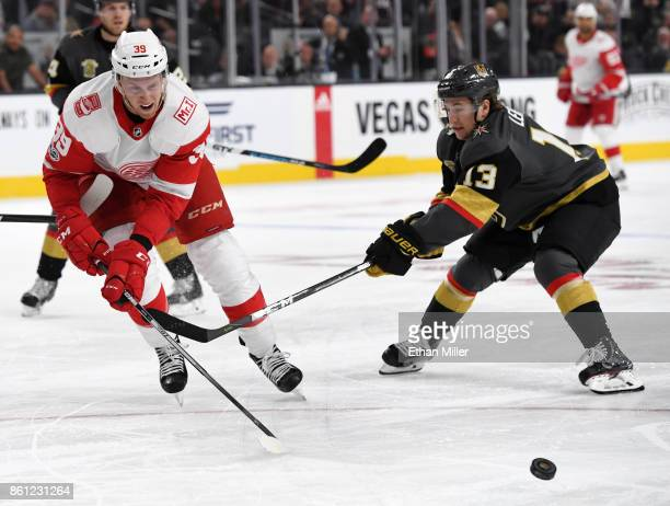 Anthony Mantha of the Detroit Red Wings passes the puck under pressure from Brendan Leipsic of the Vegas Golden Knights in the third period of their...