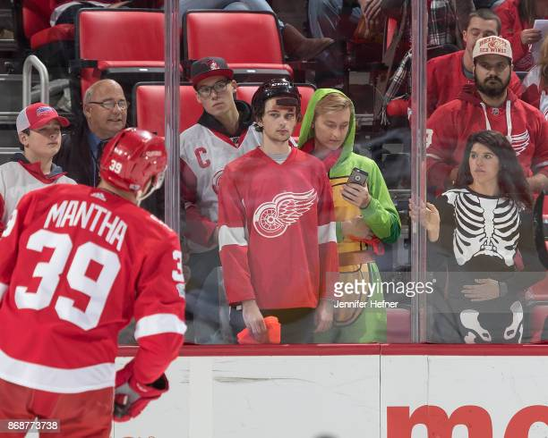 Anthony Mantha of the Detroit Red Wings skates past some fans dressed for halloween during warmups prior to an NHL game against the Arizona Coyotes...