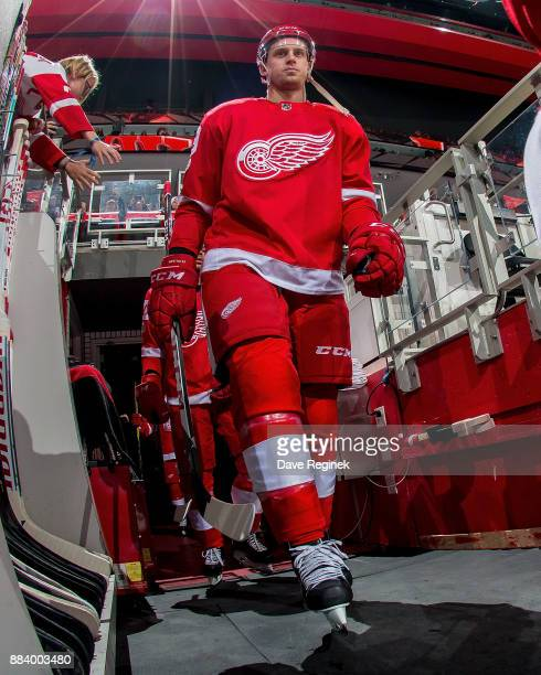 Anthony Mantha of the Detroit Red Wings walks out to the rink before the start of an NHL game at Little Caesars Arena on November 25 2017 in Detroit...