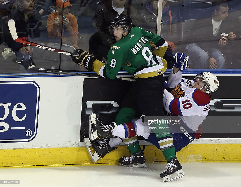 Anthony Mantha #8 of the Val-d'Or Foreurs hits Henrik Samuelsson #10 of the Edmonton Oil Kings into the boards during the second overtime period during the 2014 Memorial Cup tournament at Budweiser Gardens on May 23, 2014 in London, Ontario, Canada.