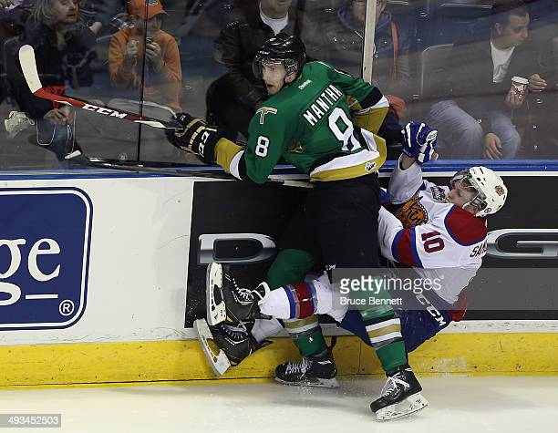 Anthony Mantha of the Vald'Or Foreurs hits Henrik Samuelsson of the Edmonton Oil Kings into the boards during the second overtime period during the...