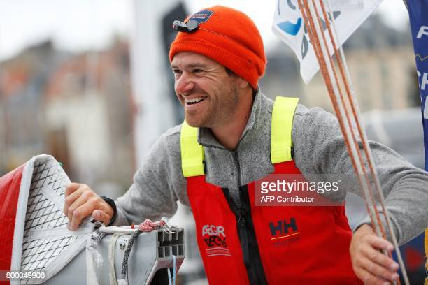 Anthony Marchand French skipper of 'Ovimpex Secours Populaire' looks on after finishing the 48th Solitaire du FigaroUrgo solo sailing race on June 23...