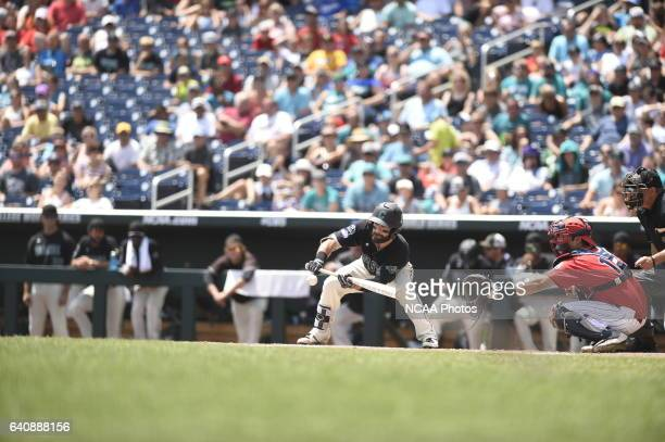 Anthony Marks of Coastal Carolina University attempts to lay down a bunt against the University of Arizona during Game 3 of the Division I Men's...