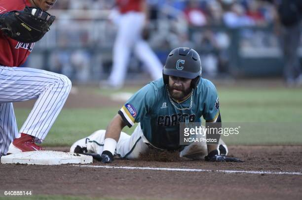 Anthony Marks of Coastal Carolina University dives back into first base against University of Arizona during the Division I Men's Baseball...