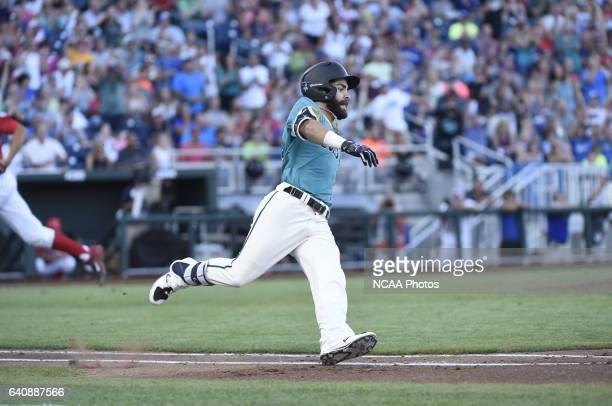 Anthony Marks of Coastal Carolina University rips a single against University of Arizona during the Division I Men's Baseball Championship held at TD...