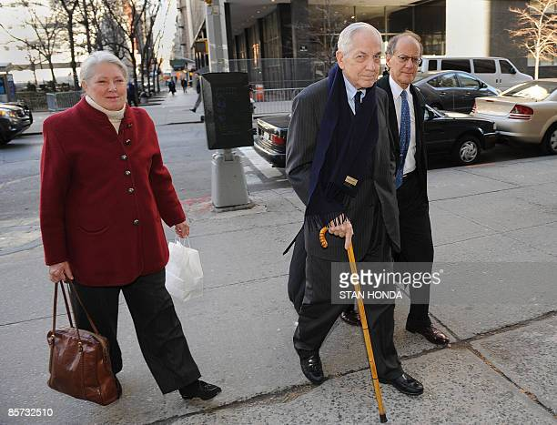 Anthony Marshall is escorted by his lawyer and wife Charlene as they arrive at Manhattan Criminal Court March 31 2009 in New York for jury selection...
