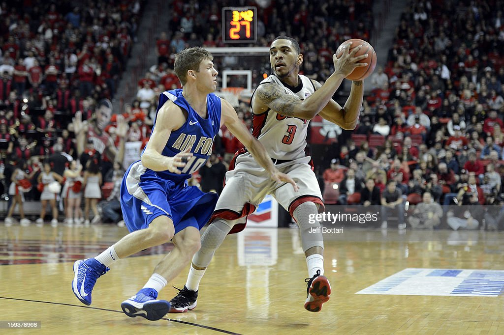 Anthony Marshall #3 of the UNLV Rebels drives against Todd Fletcher #10 of the Air Force Falcons at the Thomas & Mack Center on January 12, 2013 in Las Vegas, Nevada.