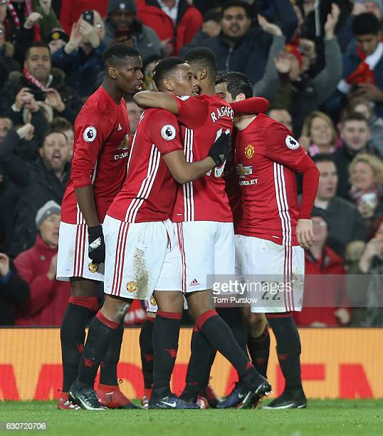 Anthony Martial and Marcus Rashford of Manchester United celebrate Paul Pogba scoring their second goal during the Premier League match between...