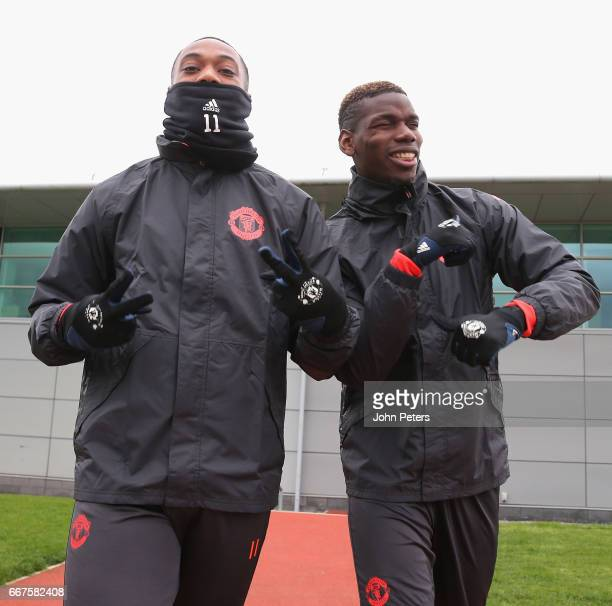 Anthony Martial and Paul Pogba of Manchester United walk out ahead of a first team training session at Aon Training Complex on April 12 2017 in...