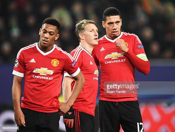 Anthony Martial Bastian Schweinstieger and Chris Smalling of Manchester look dejected during the UEFA Champions League match between VfL Wolfsburg...