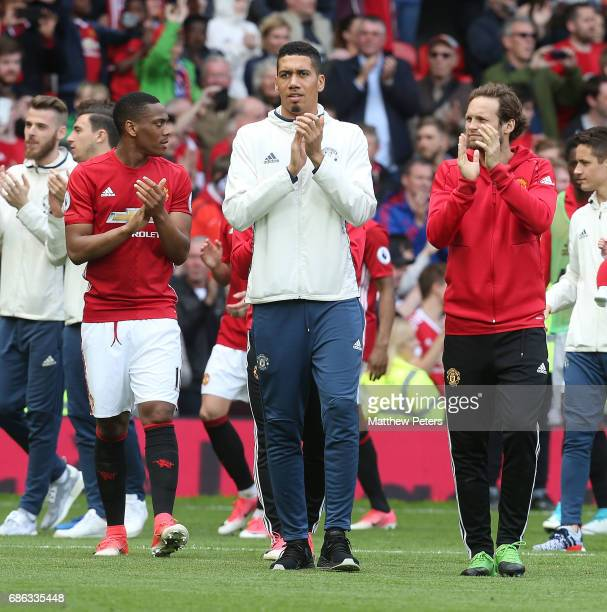Anthony Martial Chris Smalling and Daley Blind of Manchester United applaud the fans after the Premier League match between Manchester United and...