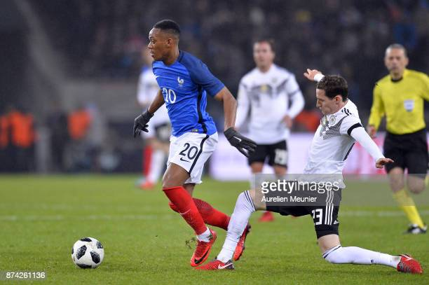 Anthony Martial of France and Lars Stindl of Germany fight for the ball during the international friendly match between Germany and France at...