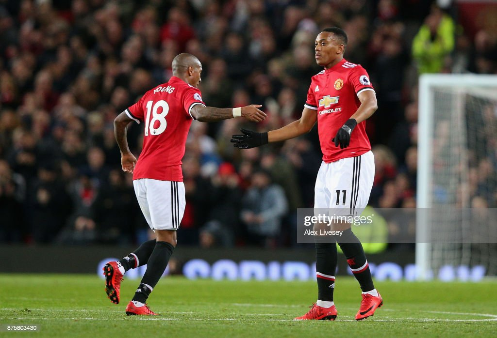 Anthony Martial of Manchester United and Ashley Young of Manchester United celebrates after Anthony Martial scores his sides first goal during the Premier League match between Manchester United and Newcastle United at Old Trafford on November 18, 2017 in Manchester, England.