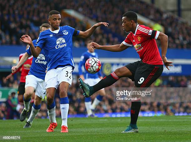 Anthony Martial of Manchester United and Brendan Galloway of Everton compete for the ball during the Barclays Premier League match between Everton...