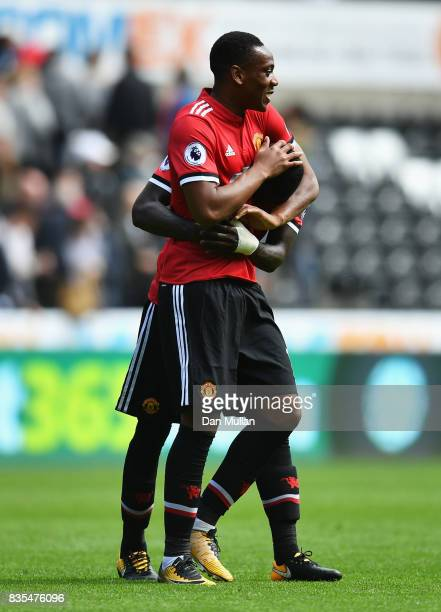 Anthony Martial of Manchester United and Eric Bailly of Manchester United celebrate victory after the Premier League match between Swansea City and...