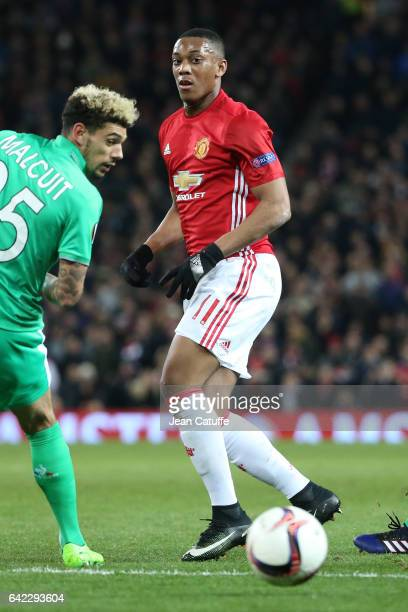 Anthony Martial of Manchester United and Kevin Malcuit of SaintEtienne in action during the UEFA Europa League Round of 32 first leg match between...