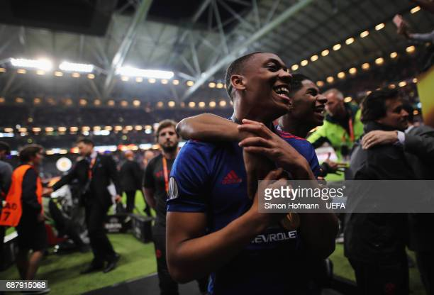 Anthony Martial of Manchester United and Marcus Rashford of Manchester United celebrate after the UEFA Europa League Final between Ajax and...