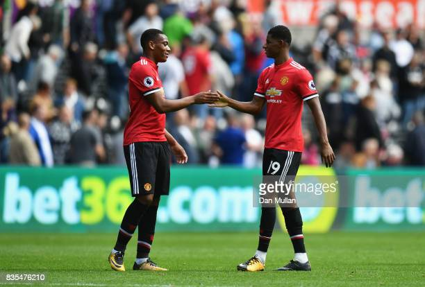 Anthony Martial of Manchester United and Marcus Rashford of Mcanchester United elebrate victory after the Premier League match between Swansea City...
