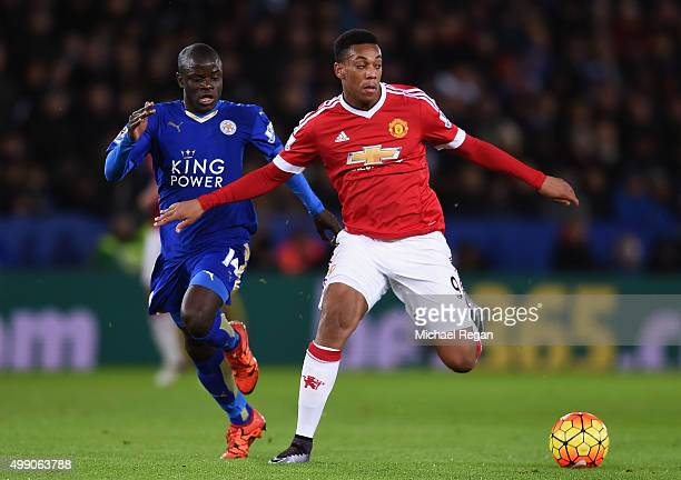 Anthony Martial of Manchester United and Ngolo Kante of Leicester City compete for the ball during the Barclays Premier League match between...