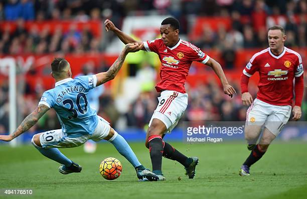 Anthony Martial of Manchester United and Nicolas Otamendi of Manchester City compete for the ball during the Barclays Premier League match between...