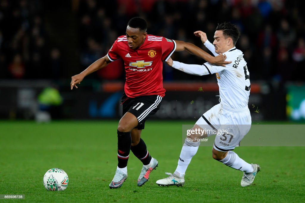Anthony Martial of Manchester United and Roque Mesa of Swansea City in action during the Carabao Cup Fourth Round match between Swansea City and Manchester United at Liberty Stadium on October 24, 2017 in Swansea, Wales.