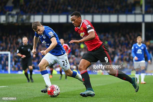 Anthony Martial of Manchester United and Seamus Coleman of Everton compete for the ball during the Barclays Premier League match between Everton and...