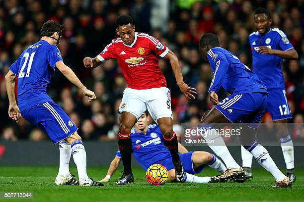 Anthony Martial of Manchester United attempts to break through Nemanja Matic of Chelsea Kurt Zouma of Chelsea and Oscar of Chelsea during the...