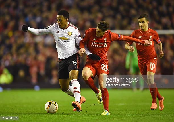 Anthony Martial of Manchester United battles with Adam Lallana of Liverpool during the UEFA Europa League Round of 16 first leg match between...