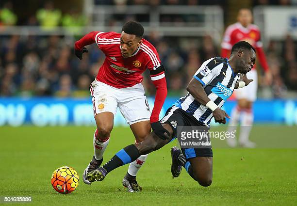 Anthony Martial of Manchester United battles with Cheik Ismael Tiote of Newcastle United during the Barclays Premier League match between Newcastle...