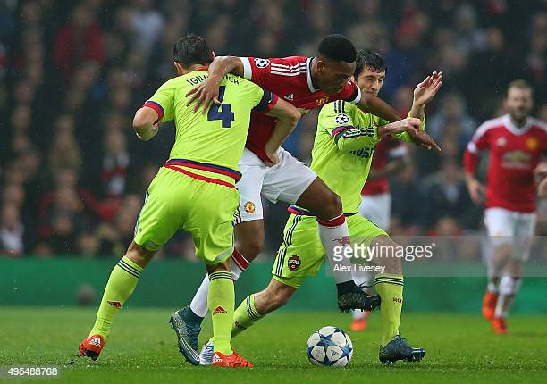 Anthony Martial of Manchester United battles with Sergey Ignashevich and Alan Dzagoev of CSKA Moscow during the UEFA Champions League Group B match...