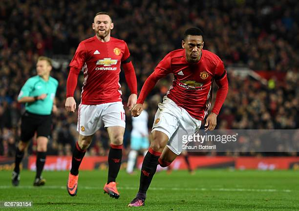 Anthony Martial of Manchester United celebrates after scoring his team's second goal of the game during the EFL Cup quarter final match between...
