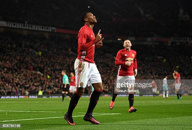 Anthony Martial of Manchester United celebrates after scoring his team's third goal of the game during the EFL Cup quarter final match between...