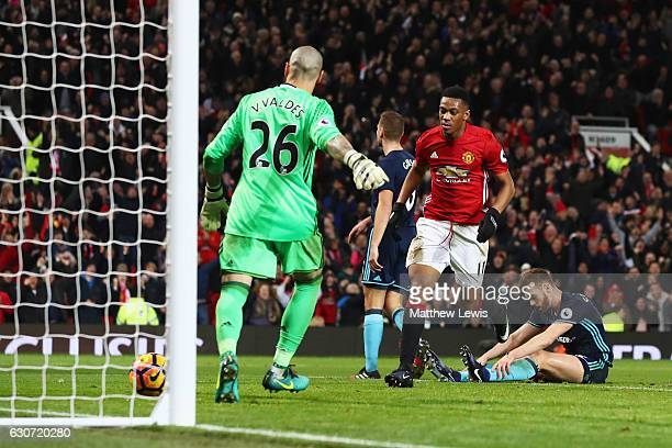 Anthony Martial of Manchester United celebrates after shoots and scores a goal during the Premier League match between Manchester United and...