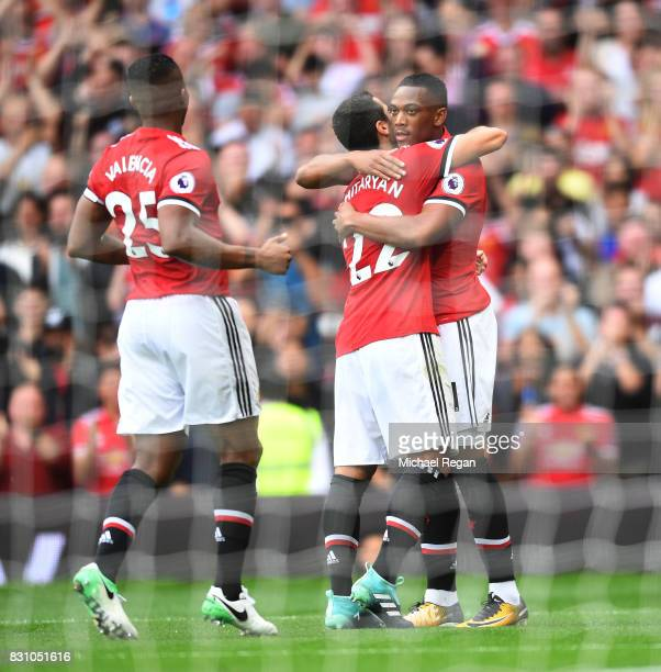 Anthony Martial of Manchester United celebrates scoring his sides third goal with Antonio Valencia of Manchester United and Henrikh Mkhitaryan of...