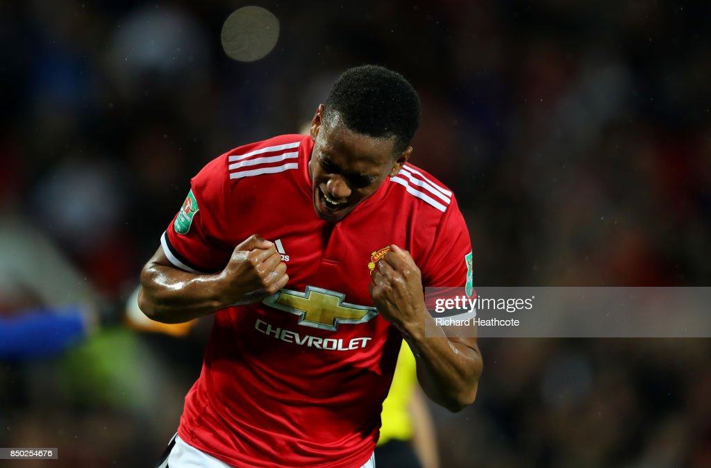 Anthony Martial of Manchester United celebrates scoring his sides fourth goal during the Carabao Cup Third Round match between Manchester United and Burton Albion at Old Trafford on September 20, 2017 in Manchester, England.