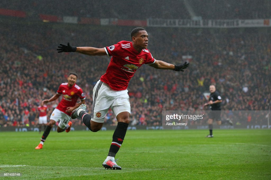 Anthony Martial of Manchester United celebrates scoring his sides first goal during the Premier League match between Manchester United and Tottenham Hotspur at Old Trafford on October 28, 2017 in Manchester, England.