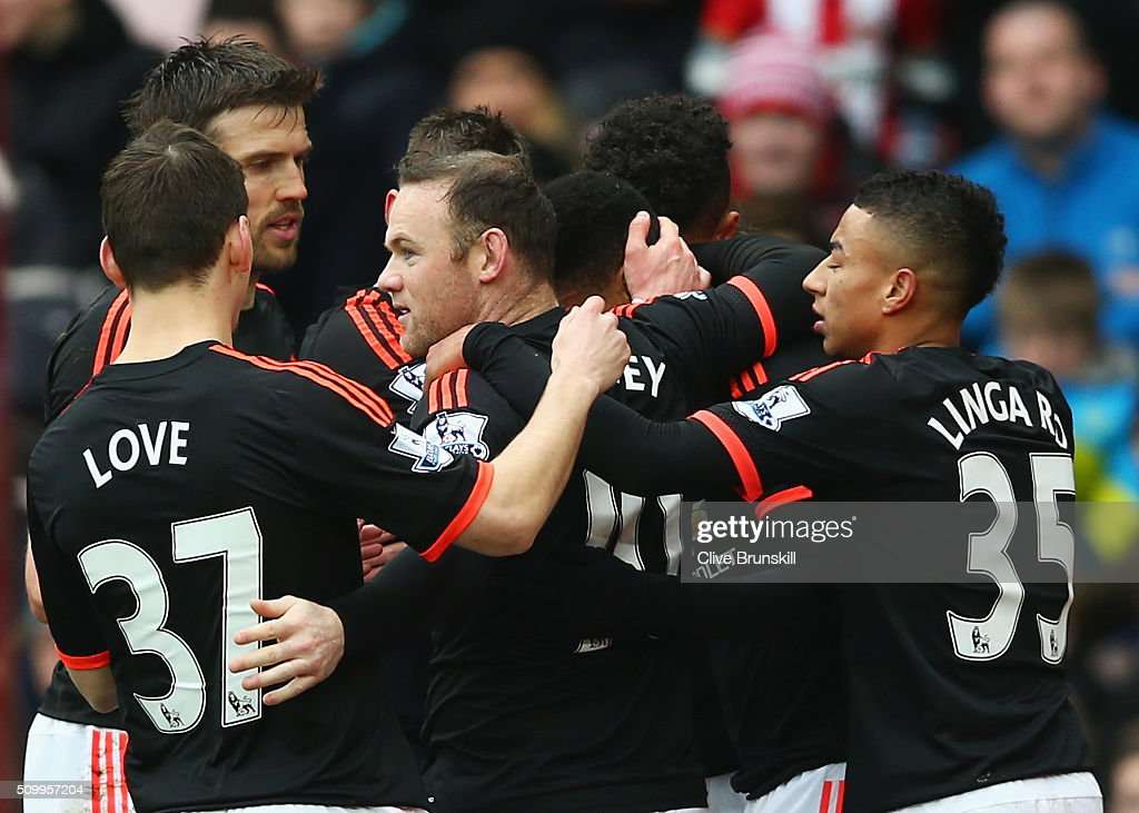 Anthony Martial (C, obscured) of Manchester United celebrates scoring his team's first goal with his team mates during the Barclays Premier League match between Sunderland and Manchester United at the Stadium of Light on February 13, 2016 in Sunderland, England.