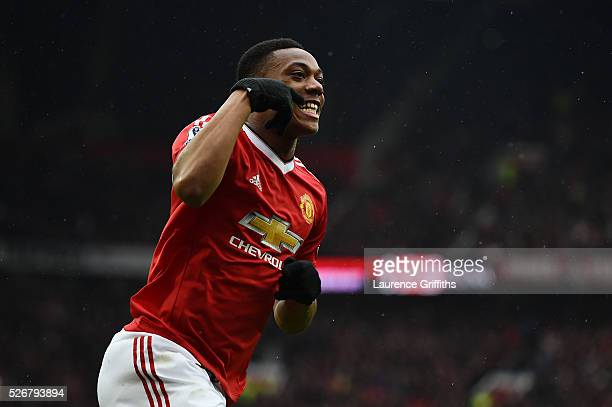 Anthony Martial of Manchester United celebrates scoring the opening goal during the Barclays Premier League match between Manchester United and...